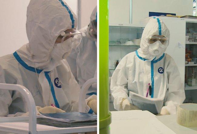 Медики временного госпиталя в «Ленэкспо» в защитных костюмах от Jiajia Holding Group. Скриншоты из видео, размещенного на сайте больницы